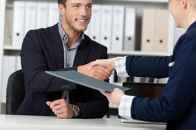 attracting new employees - a man shakes hands at the interview
